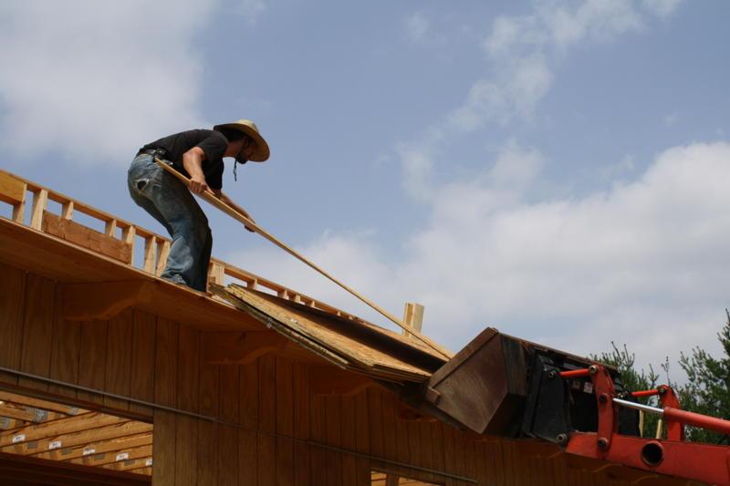 Unloading plywood